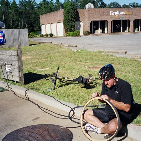 Airing up at the gas station after a flat tire.