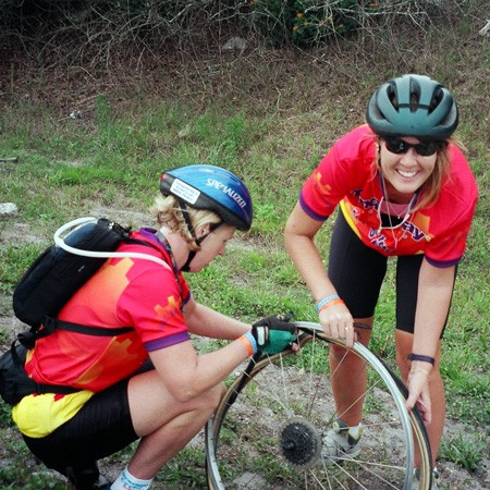 Changing a flat tire on the AIDS Ride.