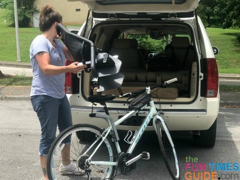 Removing the child bike seat before loading my bike into the SUV.