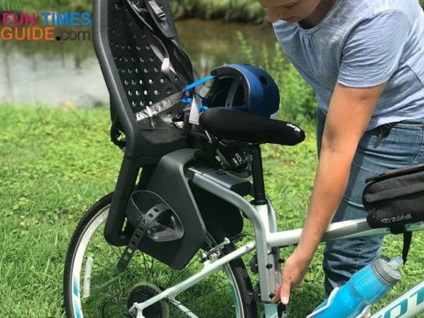 Thule Yepp Maxi rear child bike seat mounted to the frame of the bike - on the seatpost