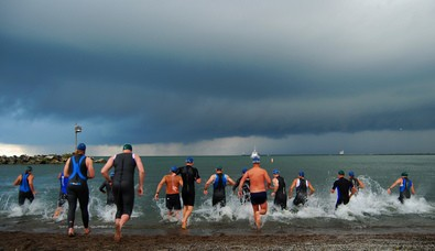 triathletes-entering-water-by-ronnie44052.jpg