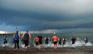 triathletes-swimmers-entering-water-by-ronnie44052.jpg