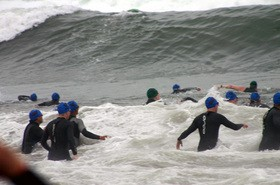 triathletes-swimming-in-waves-by-GasMunky.jpg